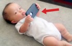 Enquanto este bebê segura o celular, acontece algo muito engraçado!
