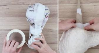 Il commence à unir des boules de papier et crée une petite œuvre d'art... parfaite pour les enfants!