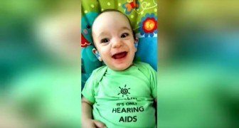 A baby finally hears its mother's voice!