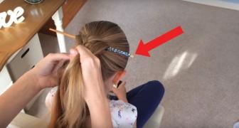 Ze brengt een eetstokje aan in haar haar en begint te vlechten: als ze het stokje verwijdert, blijft er een indrukwekkend kapsel achter!