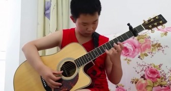 Chinese guitar child prodigy plays AC/DC on an ACOUSTIC GUITAR!