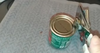 A man shows us the correct way to use a can opener! --- Did you already know this?