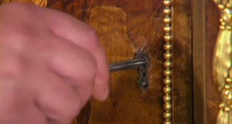 Look at what happens when the key of this 1700 piece of furniture is turned !