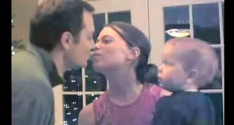 Mom and dad are kissing: but there's a jealous baby in the middle !
