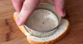 He cuts bread in circles ... the final creation looks delicious !