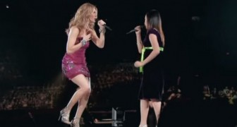 A very shy girl gets on stage with Celine Dion. The performance is epic!