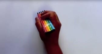 Hij begint te tekenen met 4 gekleurde pennen...het resultaat is verbluffend!