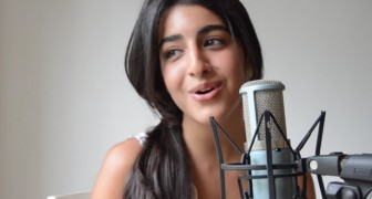 A 19 year old girl sings her version of All of Me in a beautiful way