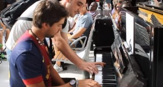 He's playing a piano in Paris station, but soon after a stranger joins him... WHOA!