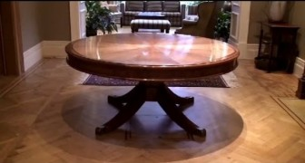It is a normal dining table, but soon reveals a surprise !