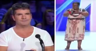 Quando sobe no palco os jurados riem dela, até que ela começa a cantar...
