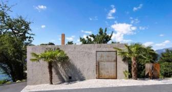 Derrière les murs de béton et un portail rouillé se trouve une maison spectaculaire