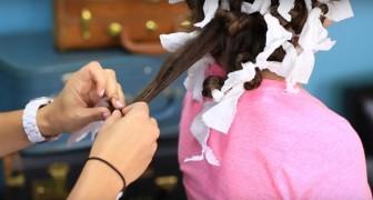Elle enroule ses cheveux autour du papier de cuisine... Le résultat? Fantastique!