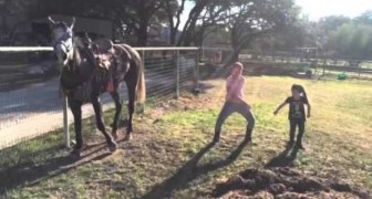 Two young girls begin to dance wildly ----The horse's reaction is a must see!