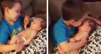 He embraces his newborn sister --- what follows is indescribably sweet!