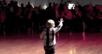 A 2 year old kid dancing Rock and Roll
