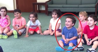 A teacher plays the guitar --- watch the little boy in blue...hysterical!