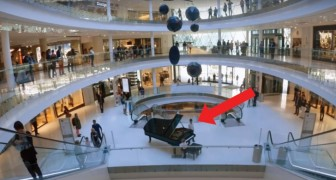 A child sits at the piano in a mall --- shortly after the show begins!