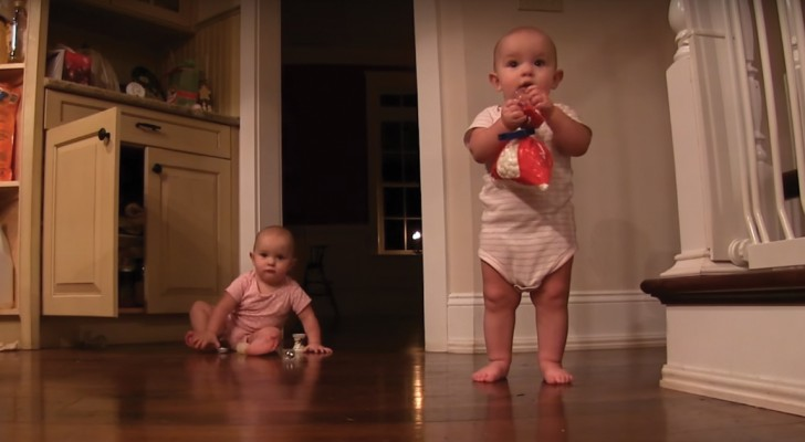 Twin babies share sweets and lots of laughs!