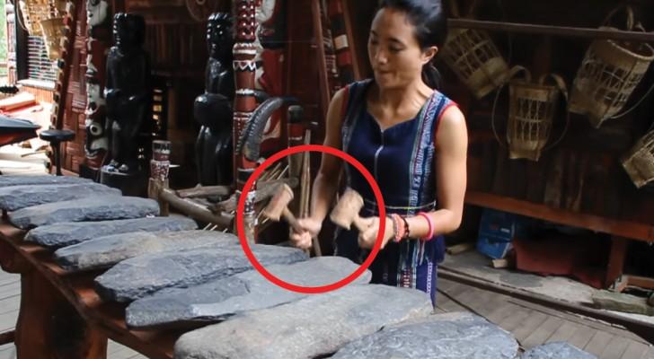 La joven vietnamita golpea las misteriosas piedras: el resultado es musica para los oidos