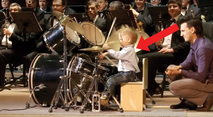 Look at what this three-year-old drummer boy can do! Astounding!