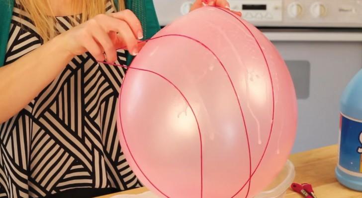 Elle enroule un fil autour d'un ballon: lorsqu'elle finit le processus, la décoration de Pâques est vraiment sympa