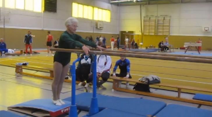 Esta senhora de 92 anos chega perto das barras paralelas, mas não se preocupe, ela sabe muito bem o que está fazendo!