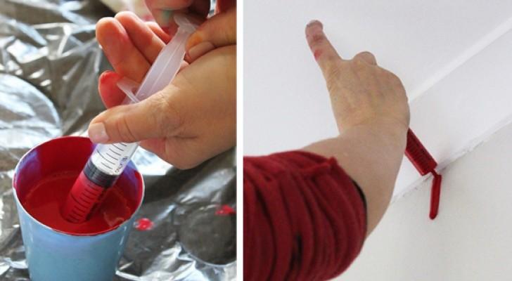 Sie zieht die Farbe in einer Spritze auf und spritzt sie dann an die Wand: Der letzte Effekt ist sehr kreativ