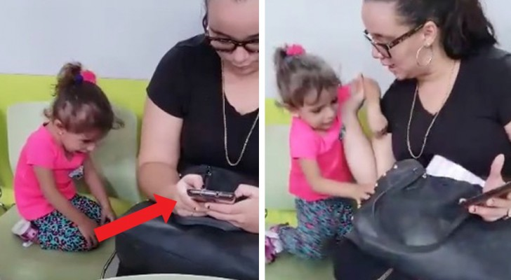 A  little girl complains because she is cold, but her mother ignores her as she busily plays with her smartphone