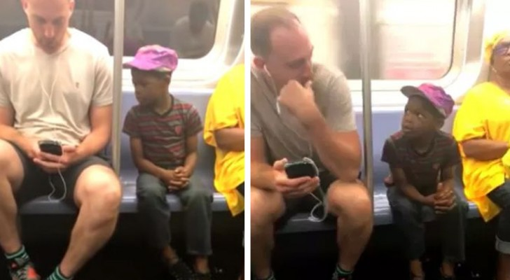 El niño continua a mirar el celular del hombre: luego èl hace un gesto que lo hace hacer dejar inmediatamente