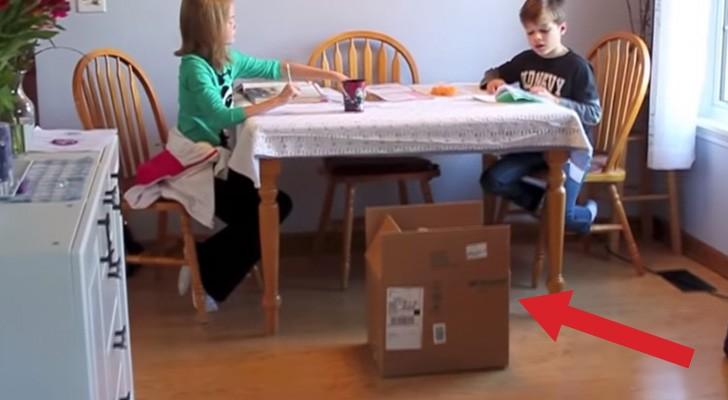 Papai coloca uma caixa misteriosa perto da mesa: veja o que acontece depois