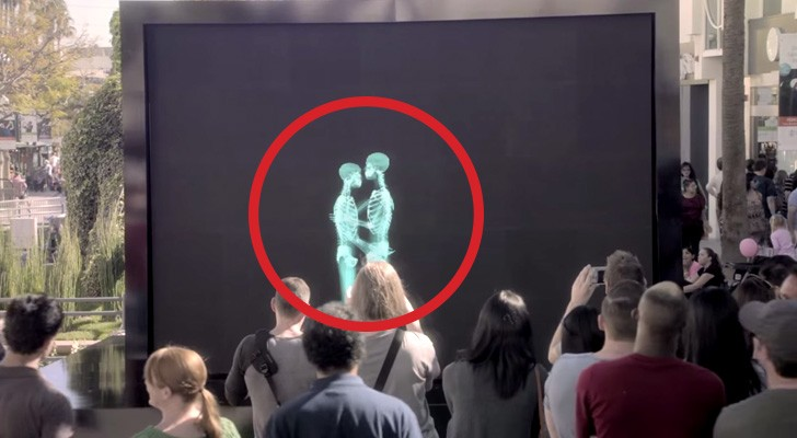 A couple is kissing behind a screen. When they come out, everyone is speechless.