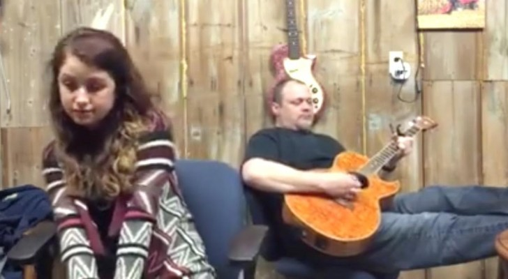 A man starts playing a famous song from 1973 --- When his daughter joins in and starts singing...Wow!
