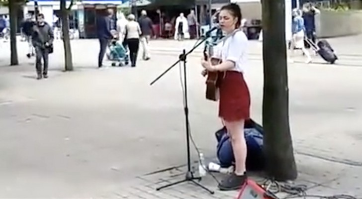 He approaches a busker --- she is excited when she recognizes him!