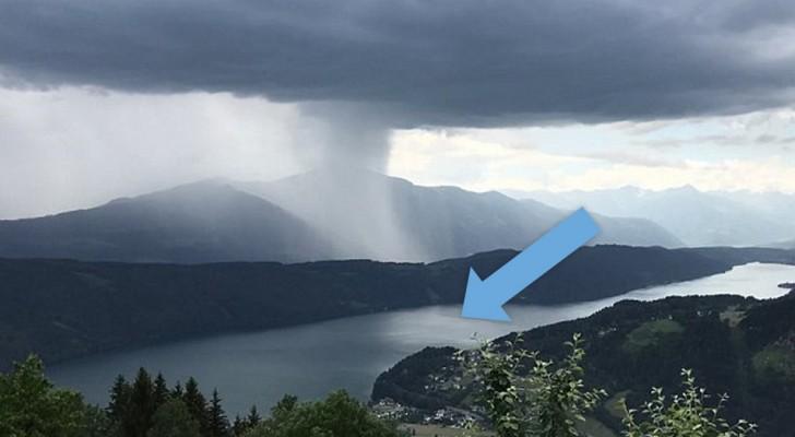 Tsunami aus dem Himmel: Der Moment als eine enorme Wolke Tonnen von Wasser in einen Alpensee ergießt